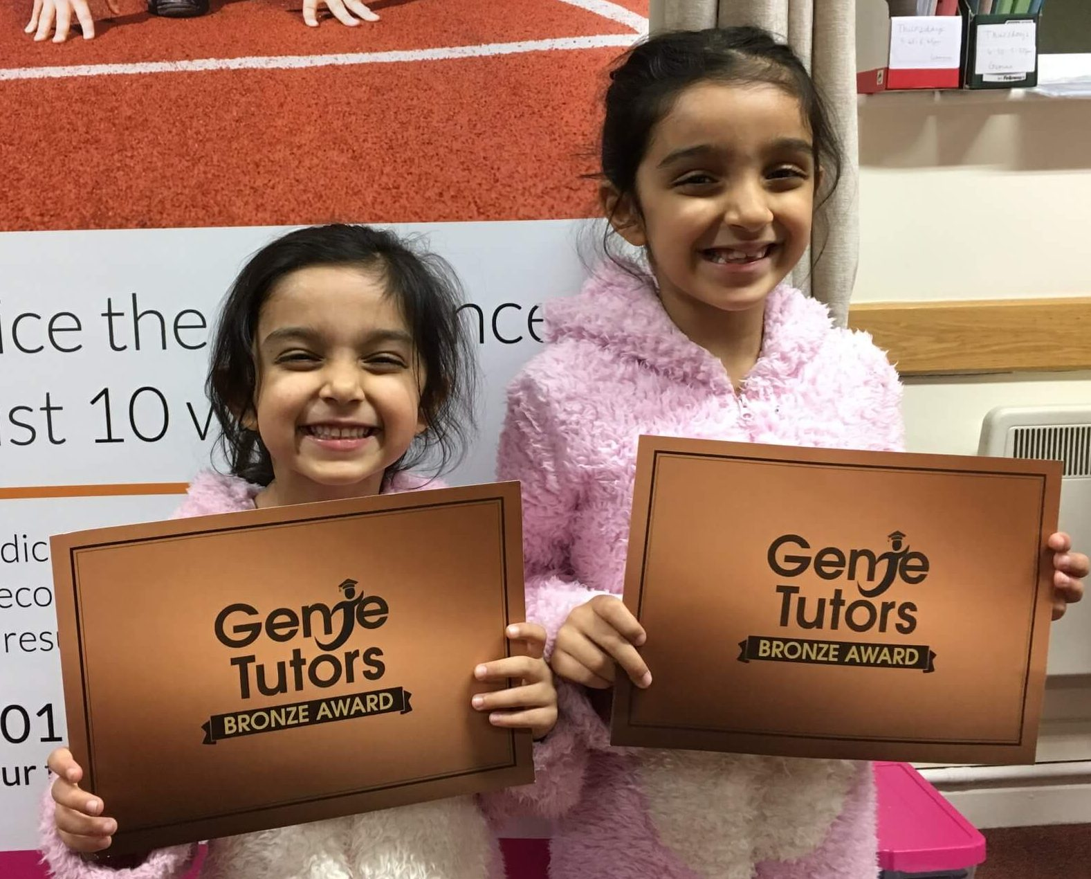 Ariayna and Alicia are smiling at Genie Tutors Redditch