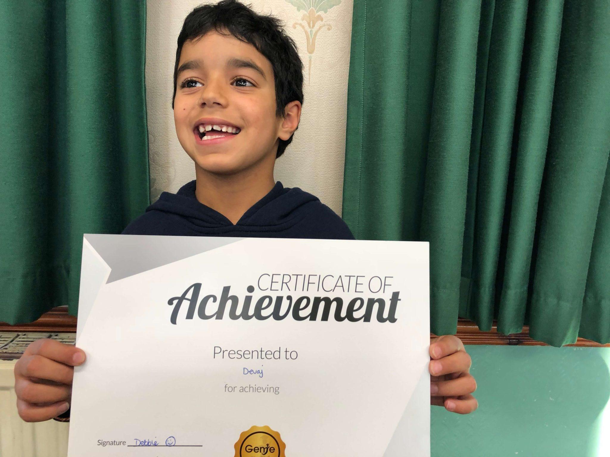 Devaj was presented with certificate for his great progress at Genie Tutors Harborne